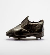 Thomas Dutton and Thorowgood Running Shoe, 1860–65Until the mid-1800s, most running shoes were made from leather — including these, thought to be the world's oldest extant pair of athletic footwear.With their elegant, pointed toe and stacked heel, they could easily be mistaken for modern dress shoes. Only the spikes on the sole and the band of leather used to support the forefoot give away their athletic intent.