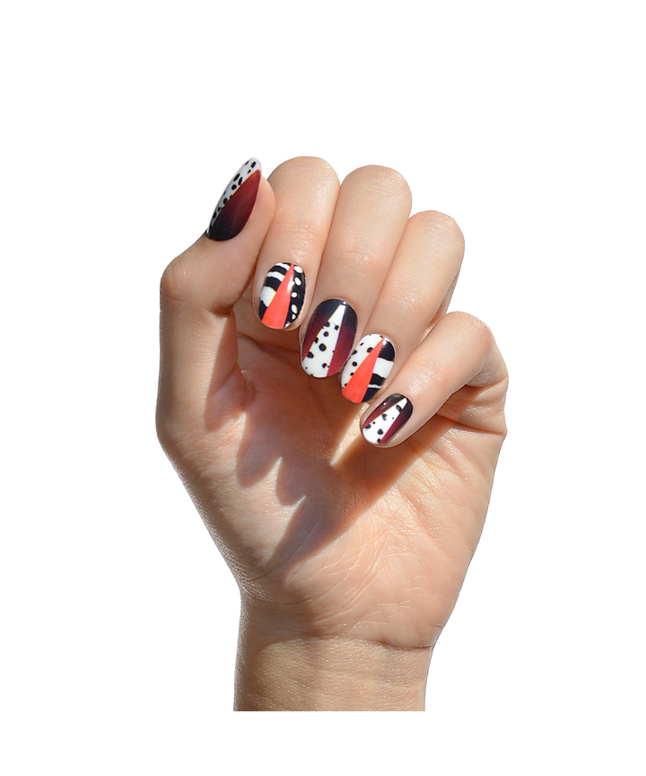 a twist on your classic red mani u2014 why not play with negative space and add a few spots
