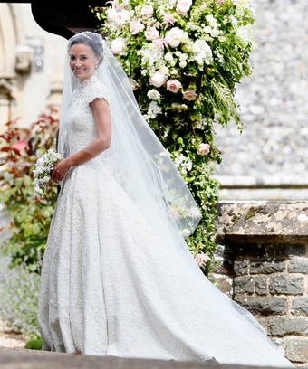 pippa middleton stuns in lace wedding gown by an unexpected designer