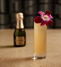 HER Favorite French 56 Ingredients:  1.5 oz Oxley gin  1 oz grapefruit juice (fresh if possible)  1 oz agave nectar  .5 oz St. Germain Elderflower Liqueur  Champagne split Steps:  Add all of the ingredients in a shaker with ice and shake vigorously. Pour into a champagne flute and top with bubbly. Garnish with an orchid.