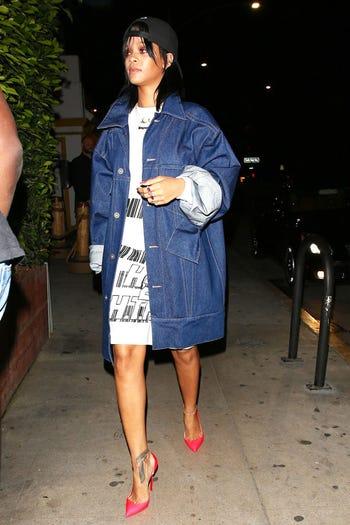 4a203ac6e3 Rihanna was photographed at Giorgio Baldi wearing an oversized jean jacket  over a t-shirt worn as a dress