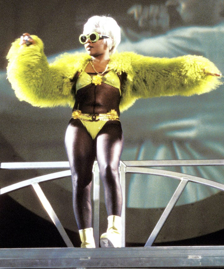 Lil Kim performing on stage