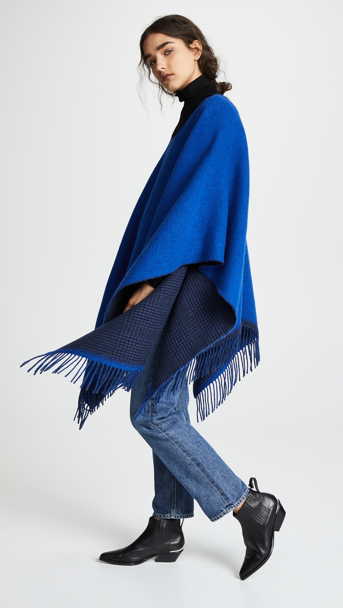 6ed552d54ec https://www.refinery29.com/en-us/winter-cape-poncho 2018-11-30T18 ...