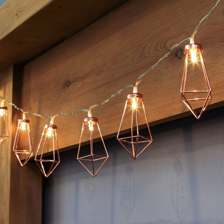 Leave It To The Cage Like Embellishments On These String Lights Add An  Industrial Vibe To Your Space.