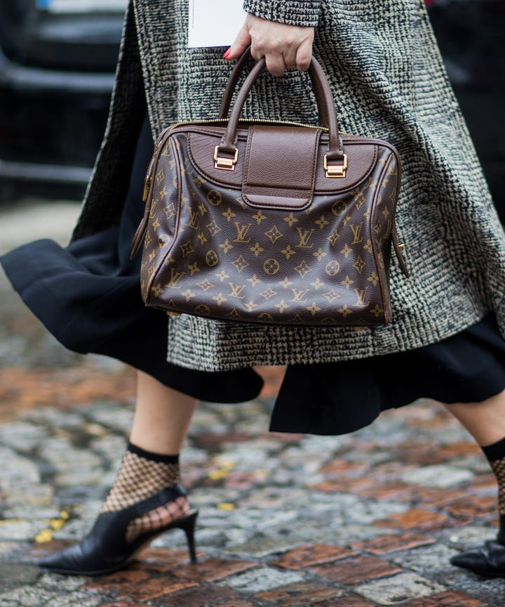 louis vuitton logo handbag trend street style accessory