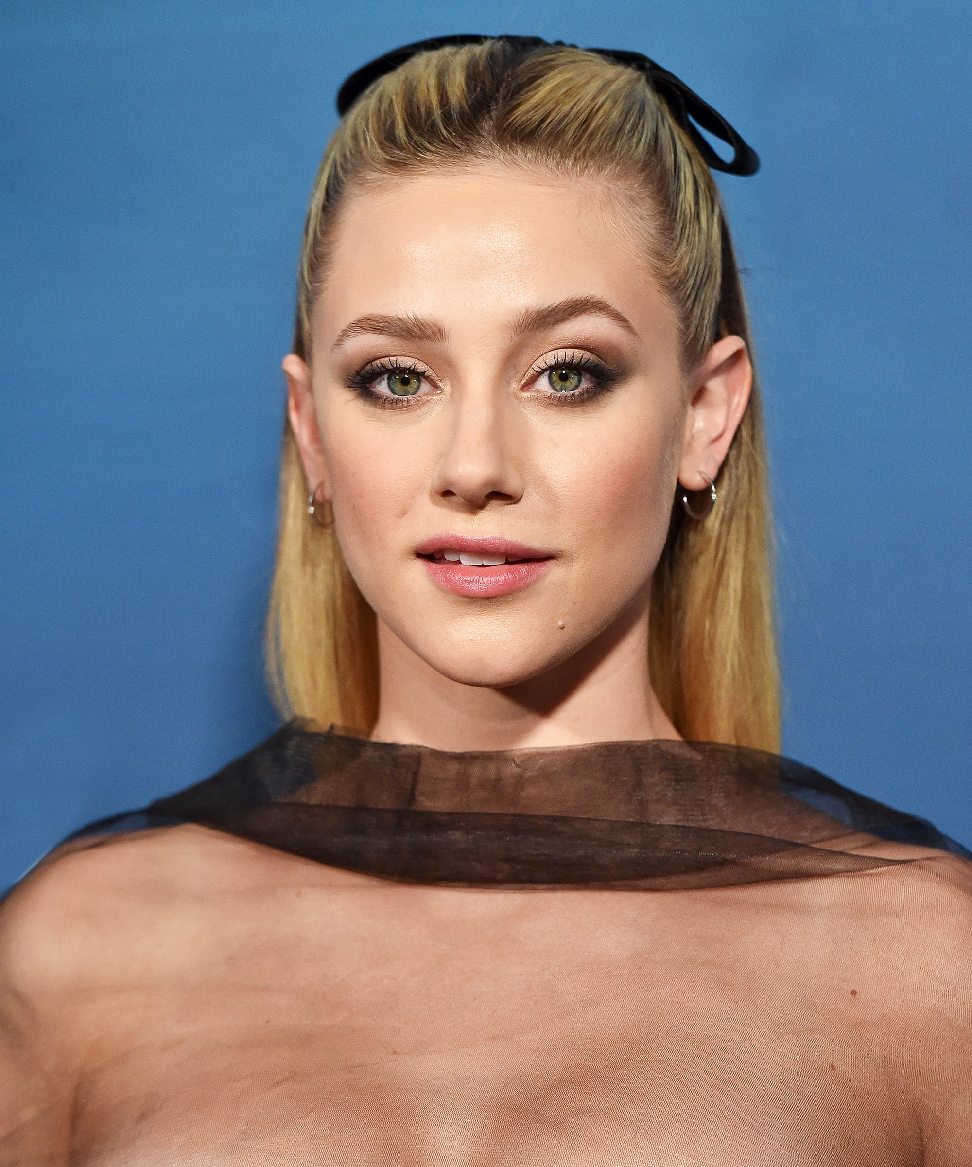 33b0e705bbfd2 Celebrities Love This Throwback Hair Bow Ribbon Trend