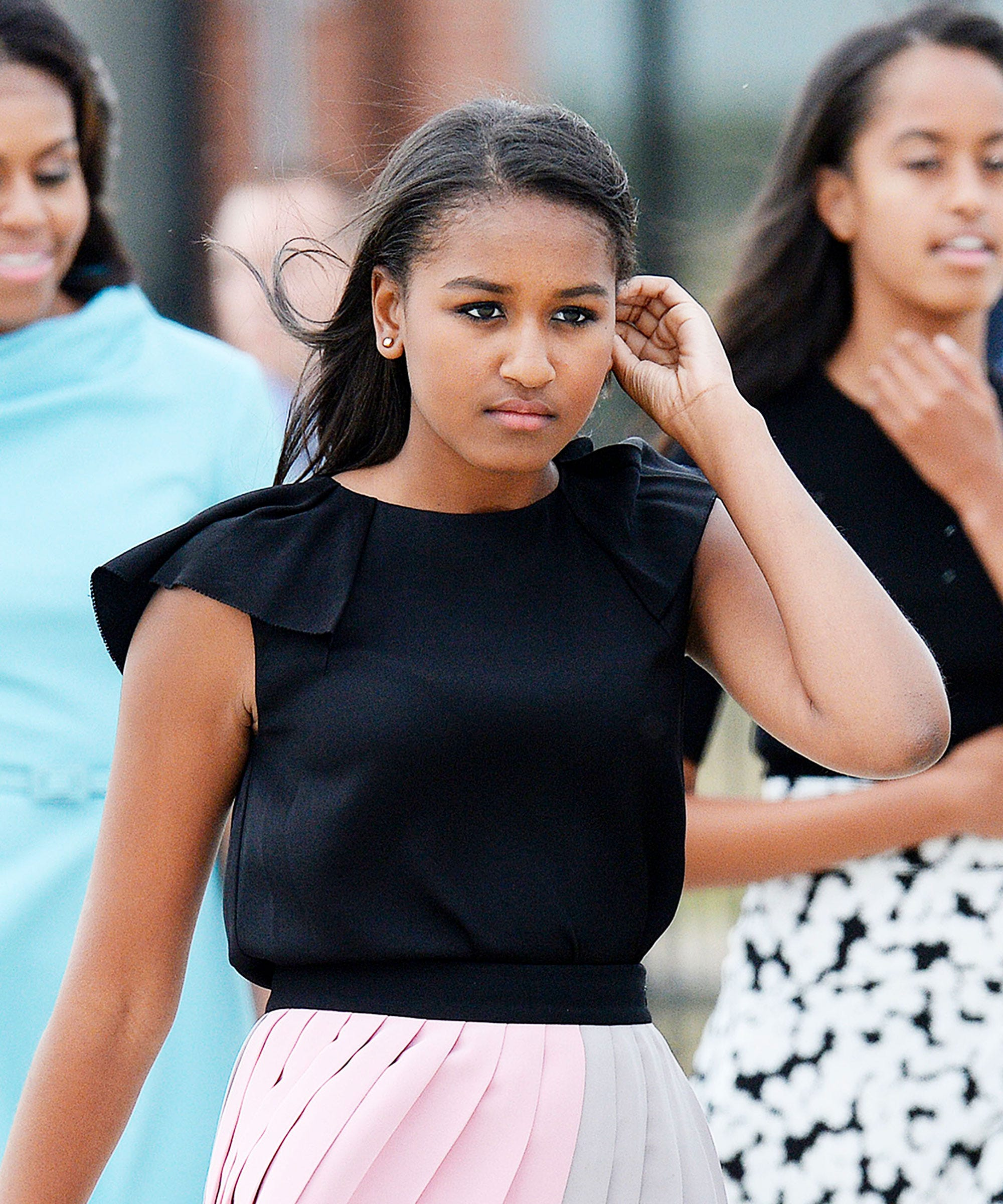 Sasha Obama Proved That Slip Dresses & Sneakers Are The Ultimate Summer Outfit Formula