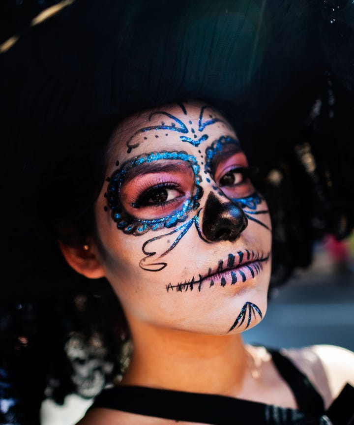 among the many faces in the crowds filling the streets to celebrate da de los muertos or the day of the dead this weekend there will likely be a very