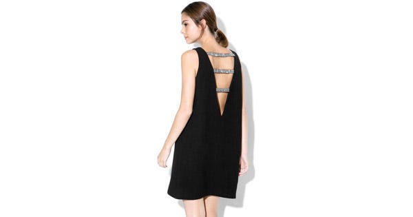 11 Open-Back Dresses That Dare You To Defy The Cold