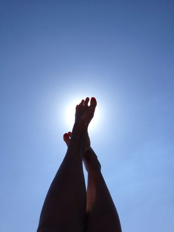 legs against sky summer