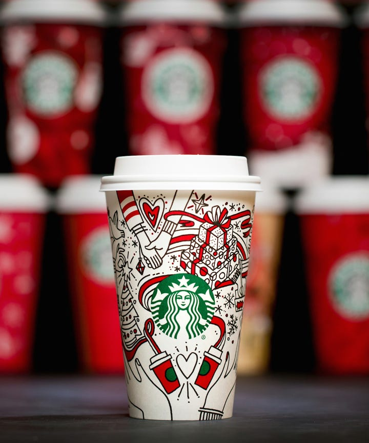 a look at every single starbucks holiday cup from the past 21 years