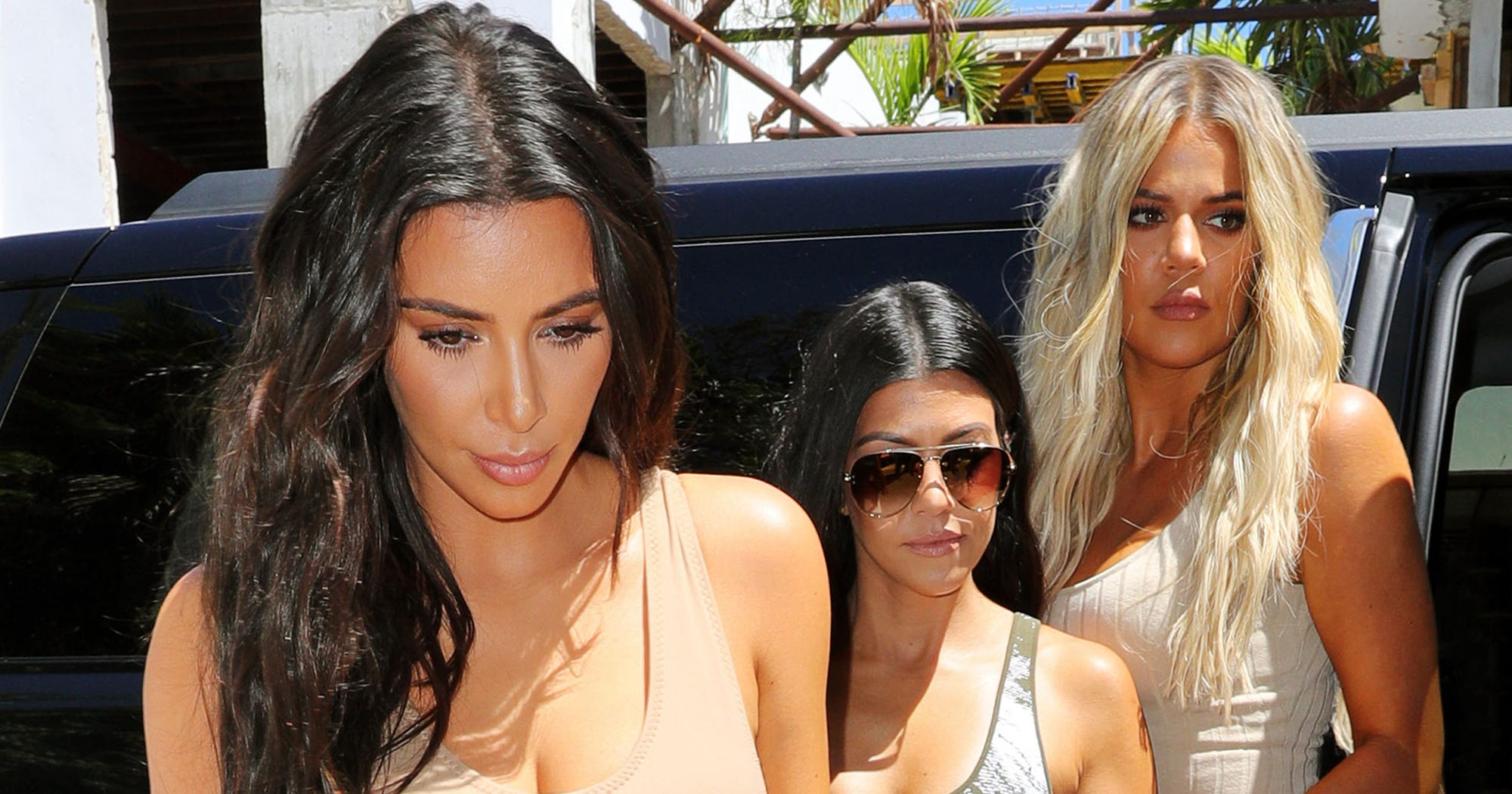 The Reason Behind Kim And Kourtney Kardashian's Dramatic Fight