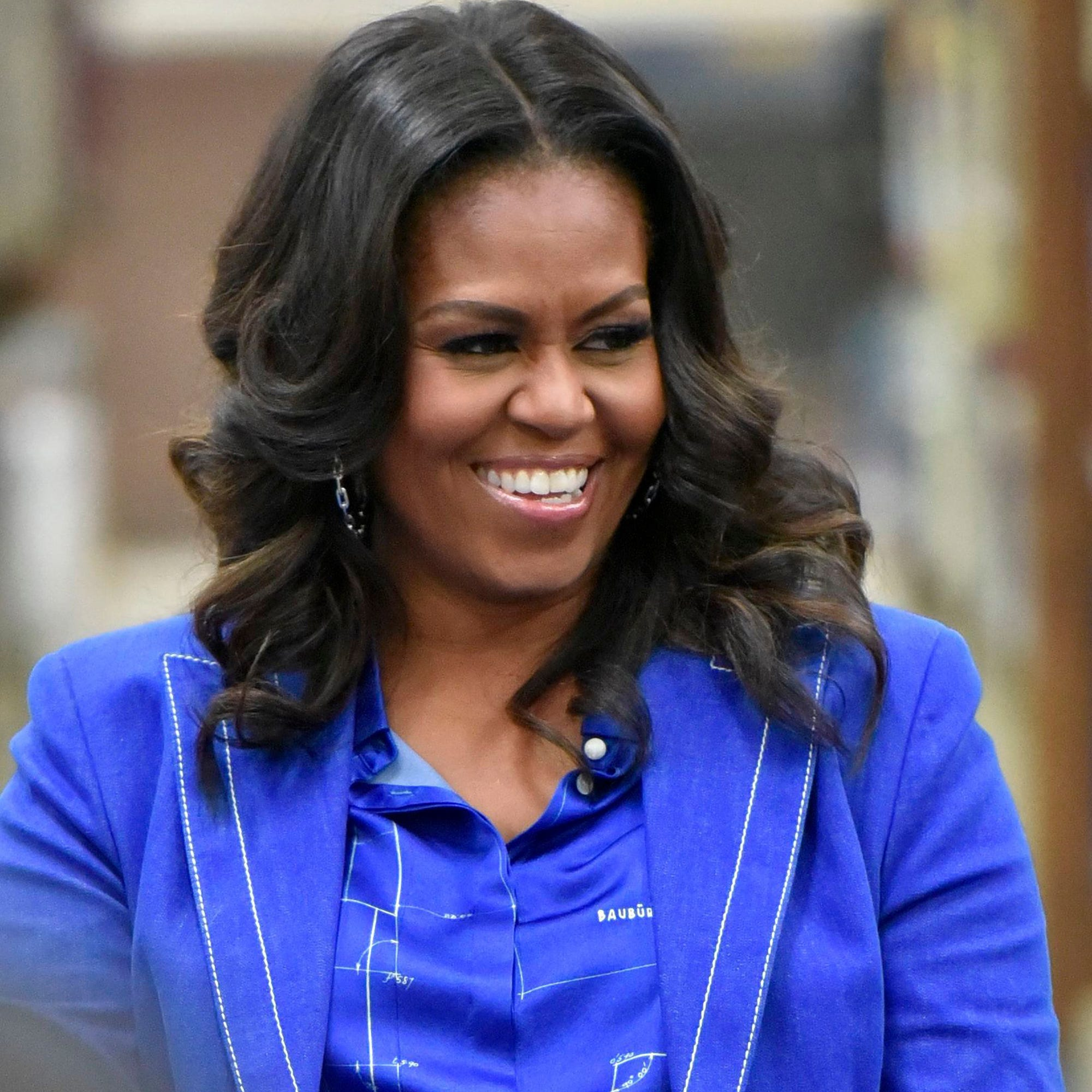 Michelle Obama Rocks Curly Natural Hair On Essence